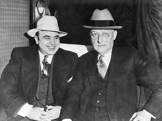 May 1932: USM H.C.W. Laubenheimer sitting next to Al Capone on train ride to prison in Atlanta.