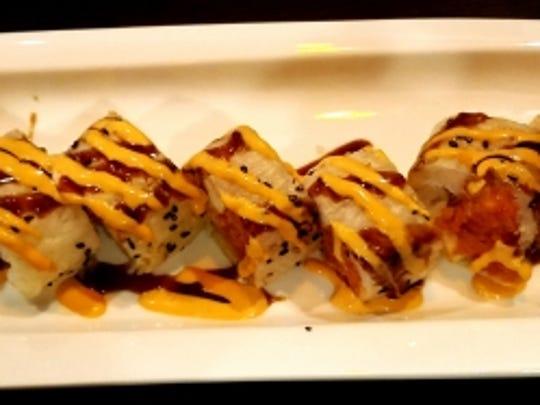 Hokkaido's fantasy roll had spicy tuna, avocado, shrimp, kani (sushi rice) and was topped with an avocado and eel sauce.