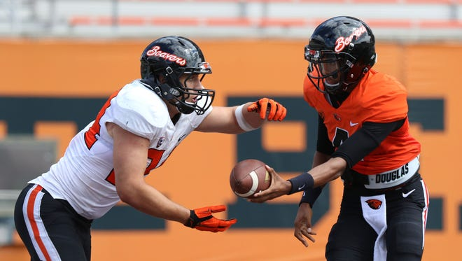Oregon State quarterback Seth Collins hands the ball of to Ryan Nall during a scrimmage on Saturday, Aug. 15, 2015, in Corvallis, Ore.
