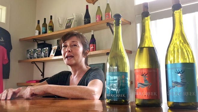 Vineyard owner Katherine Bryan laughs as she discusses the wines available for tasting at Deer Creek Vineyards in Selma, Ore.