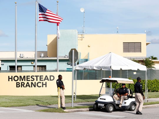 Security guards stand outside a former Job Corps site that now houses child immigrants, Monday, June 18, 2018, in Homestead, Fla. It is not known if the children crossed the border as unaccompanied minors or were separated from family members. An unapologetic President Donald Trump defended his administration's border-protection policies Monday in the face of rising national outrage over the forced separation of migrant children from their parents.