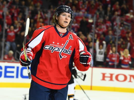 Washington Capitals center Nicklas Backstrom  reacts after scoring a goal against the Boston Bruins during the first period at Verizon Center.