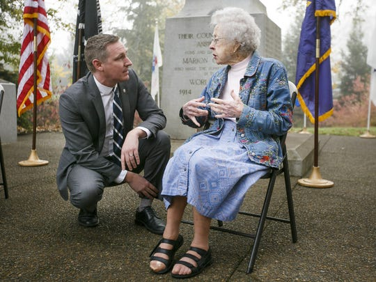 Oregon Department of Veterans' Affairs Director Cameron Smith talks to World War II Army nurse Jean Wojnowski, 101, who served in the South Pacific.
