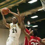 Catamounts Guard Dre Wills (24) leaps to take a shot during the men's basketball game between the Marist Red Foxes and the Vermont Catamounts at Patrick Gym on Sunday afternoon November 29, 2015 in Burlington.