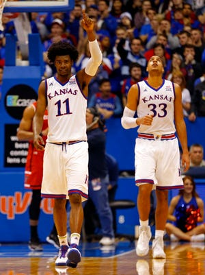 Kansas guard Josh Jackson celebrates with teammate Landen Lucas  during the second half against Texas Tech.
