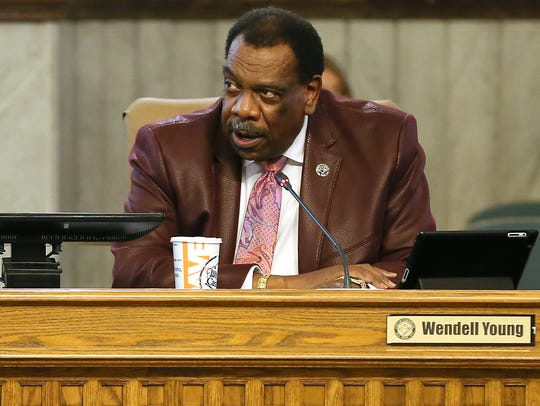 Cincinnati City Councilman Wendell Young and other members of Cincinnati City Council discuss city business and a severance package for City Manager Harry Black on Wednesday.