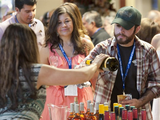 Geoff Breashears of Porterville samples wine at Bank of the Sierra during Taste of Downtown Visalia 2014. Bank of Sierra will again host the wine tasting during this years Taste of Downtown.