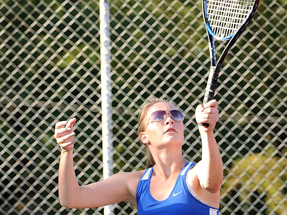 St. Peter's Natalie Zitko serves during Wednesday's match against Marion Harding.