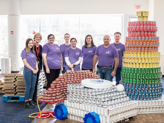 During an annual event called Canstruction, local architects, engineers, construction companies and other organizations come together to create holiday-themed sculptures using canned foods, with all the food donated to Second Harvest.
