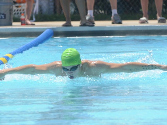 Mountain Home Hurricanes swimmer Patrick Leppold competes in a butterfly event Saturday at a meet at Cooper Park.