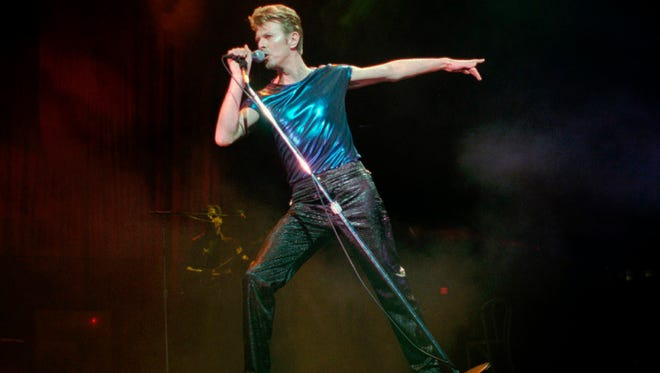 David Bowie performs in Hartford, Connecticut in 1995.