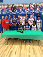 Las Cruces High boys basketball player RJ Brown (seated,