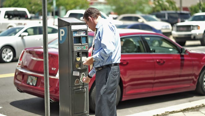 Parking pay stations can be found around downtown Pensacola. For $2.50 you can park five hours.