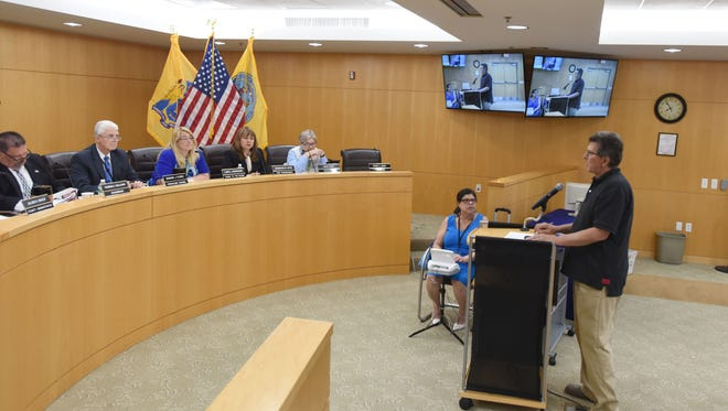 Mark Fisher, Bergen County Audubon member, speaks at the Freeholder meeting on the county plans to use a 75-acre tract in Teaneck to house an animatronic dinosaur display.