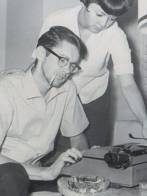 Jack Cannon and wife Leslie Cannon are pictured in 1965 in the Sinton Hotel writing for The Enquirer.