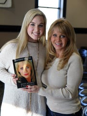 Logan Cloud poses with Irlene Mandrell at Mandrell's book signing Friday at TCA in Jackson.
