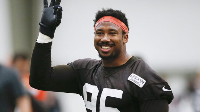 FILE - In this June 6, 2019, file photo, Cleveland Browns defensive end Myles Garrett reacts after a play during practice at the team's NFL football training facility in Berea, Ohio. The Cleveland Browns are closing in on a massive contract extension with Garrett, a person familiar with the negotiations told the Associated Press on Tuesday, July 14, 2020. Garrett, the No. 1 overall pick in 2017 and one of the NFL's premiere edge rushers, and the team could have the deal completed in the next day or so, said the person who spoke on condition of anonymity because of the sensitivity of the talks.