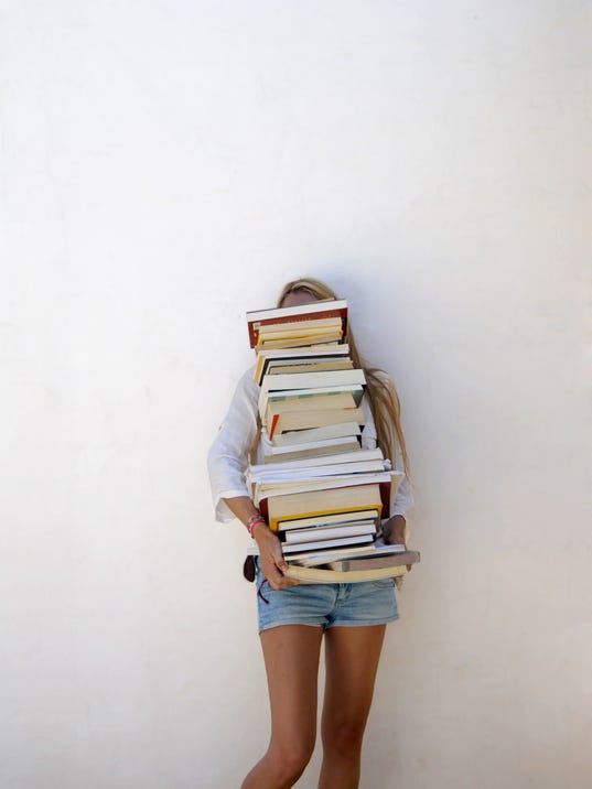 High School Student Holding Lots of Books
