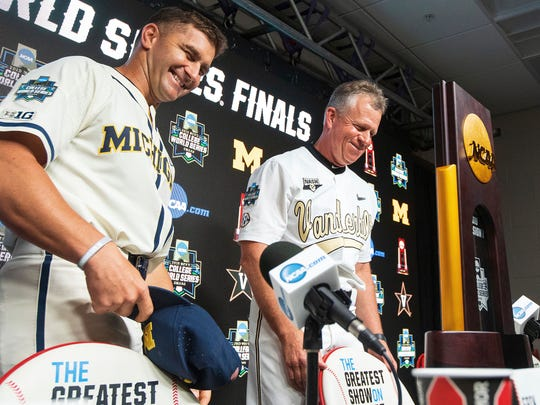 Michigan coach Erik Bakich and Vanderbilt coach Tim Corbin share a laugh during a news conference Sunday, in Omaha, Neb.