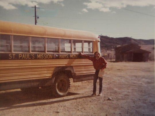 Frank McCann poses beside the St. Paul Mission school