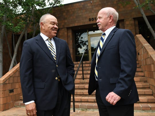 Longtime Greenville schools administrators Dr. Ken Peake, left, and Leroy Hamilton stand outside the Greenville School district office on Friday, June 2, 2017. The two will be retiring this summer.
