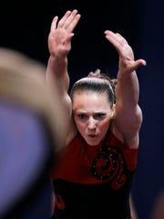 Gymnast Chellsie Memmel dives towards a spring board