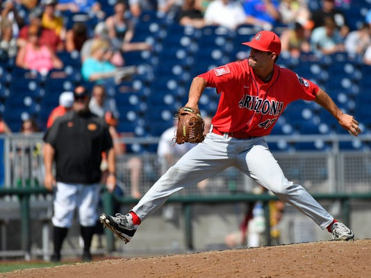 Arizona's Cameron Ming (47) pitches against Oklahoma State in the fifth inning of an NCAA men's College World Series baseball game, Friday, June 24, 2016, in Omaha, Neb. (AP Photo/Ted Kirk)