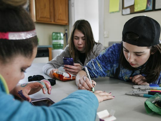 From left, eighth-grader Aaliyah Cary, freshman Julianna Weiss, and eighth-grader Jaime Thompson of Grand Ledge get creative at YES or Youth Enrichment Services of Grand Ledge.
