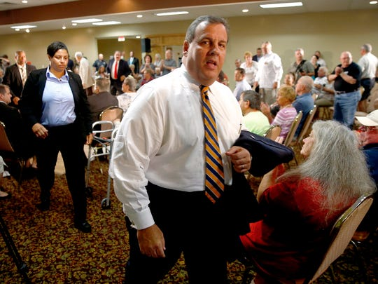 New Jersey Governor Chris Christie departs a town hall meeting on his new school funding formula at the Bayville Elks Lodge Thursday, September 15, 2016.