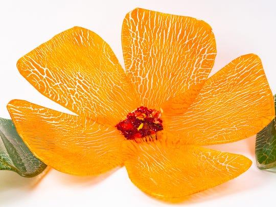 Cheryl Sattler's orange flower with leaves is part