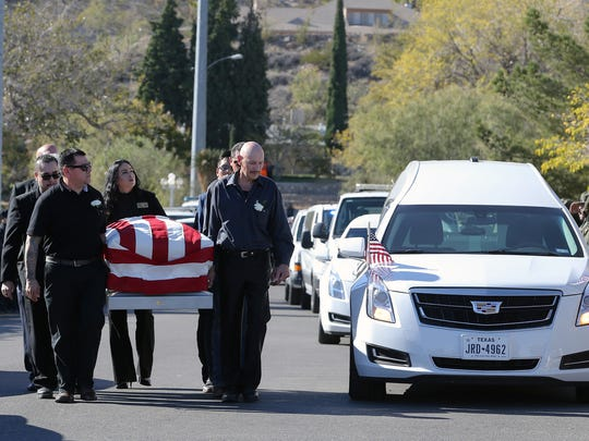 Pall bearers carry the body of U.S. Border Patrol Agent Rogelio Martinez into Our Lady of Guadalupe Church in El Paso for his funeral mass Saturday.
