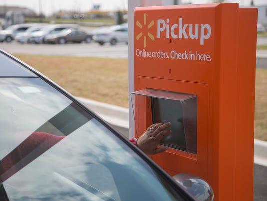 636585245005540499-a-customer-checks-in-at-the-grocery-pickup-kiosk.jpg