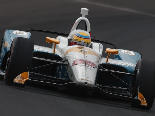Harding Racing IndyCar driver Gabby Chaves (88) rounds turn three on qualification day for the Indianapolis 500 at the Indianapolis Motor Speedway on Saturday, May 19, 2018.