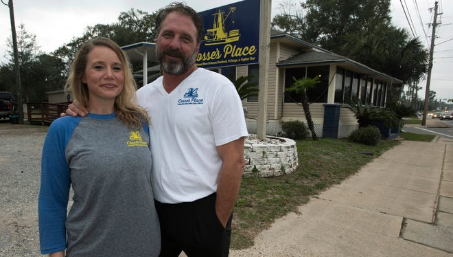 Carolanne Savage, left, and Mike Cosse stand outside their new restaurant, Cosse's Place, on Wednesday, Nov. 8, 2017, in Milton. The New Orleans-style restaurant is expected to open in late November.