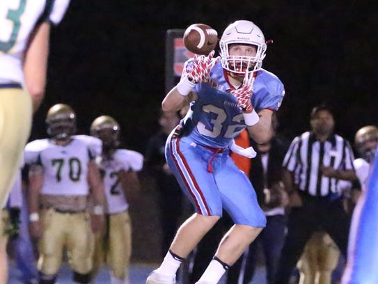 USJ receiver Ryan Miller makes a catch against Friendship