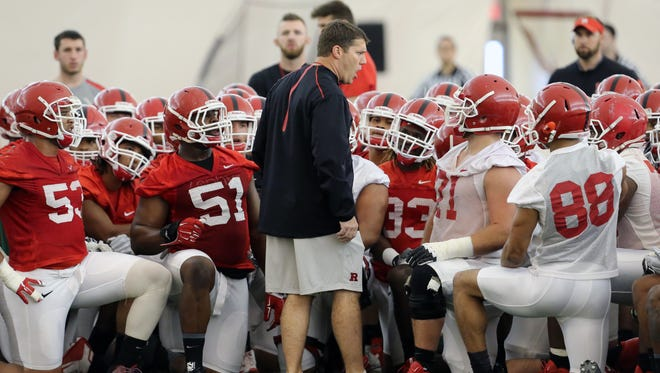 Rutgers coach Chris Ash barks orders as his team at the first spring football practice.