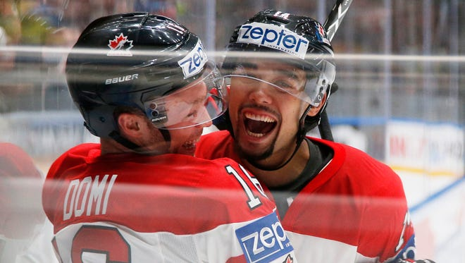 Canada's Max Domi, left, and Matt Dumba celebrate a goal  during the Hockey World Championships quarterfinal match between Canada and Sweden  in St.Petersburg, Russia, Thursday, May 19, 2016.