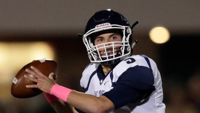 Bay Port's Quinn Pierner looks to throw at De Pere on Oct. 14. The senior quarterback totaled 353 yards of offense Friday in a WIAA Division 1 first-round victory over Appleton North.