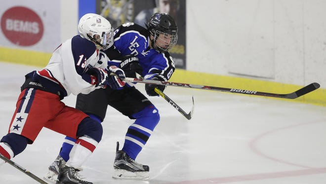 Hunter Schwehr, left, defends against Noah Guyette of Fond du Lac Springs during a Dec. 13 game at Tri County Ice Arena in Fox Crossing.