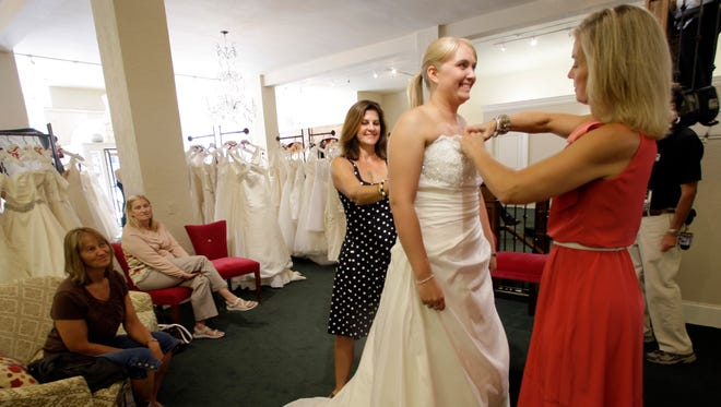 A bride-to-be tries on a wedding dress at Zita in 2012.