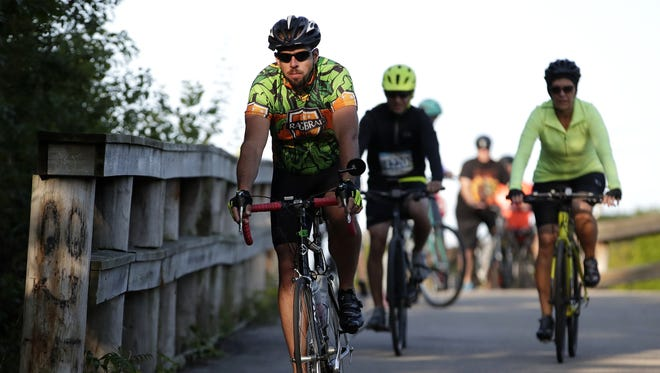 Riders head down the Newberry Trail on Saturday morning during Bike to the Beat, a bike ride held in conjunction with the Mile of Music festival.
