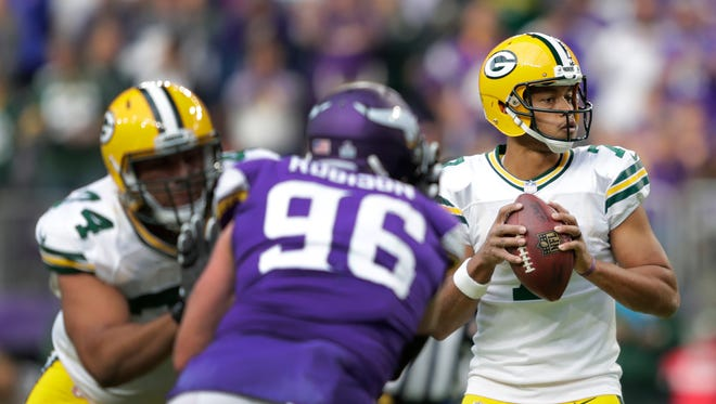 Green Bay Packers quarterback Brett Hundley (7) looks to pass as offensive tackle Ulrick John (74) blocks Minnesota Vikings defensive end Brian Robison (96) in the fourth quarter during their football game Sunday, October 15, 2017, at U.S. Bank Stadium in Minneapolis, Minn.