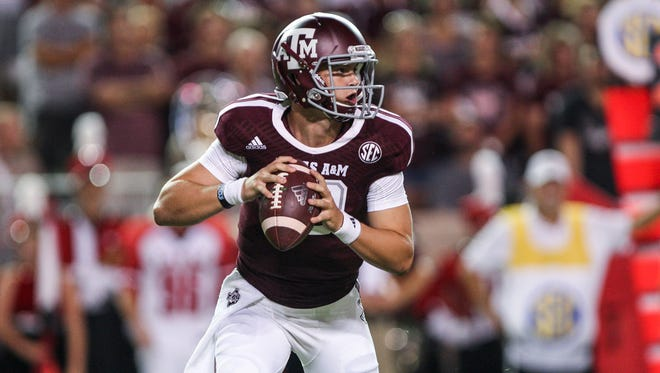 Texas A&M Aggies quarterback Kyle Allen (10) looks for an open receiver during the second quarter against the Lamar Cardinals at Kyle Field.