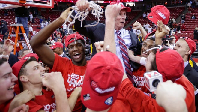 Wisconsin coach Bo Ryan, center, is hoisted by his team after Wisconsin beat Michigan State Sunday in Madison. The Badgers have bigger goals than the Big Ten title.