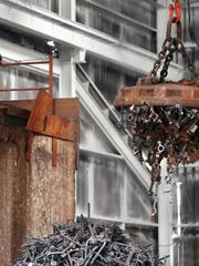 A giant 8,000 pound magnet that can hold up to five tons of scrap moves metal to a furnace at ID Castings.