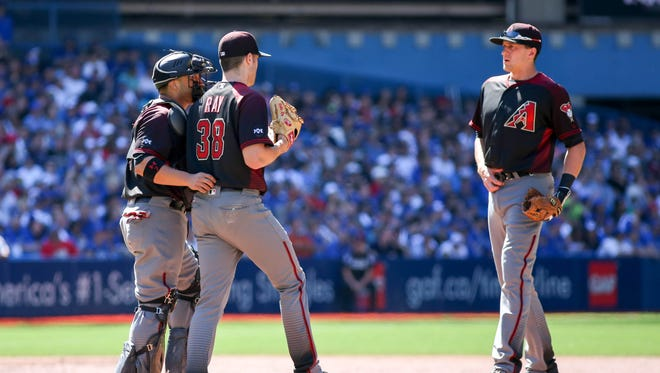 Jun 22, 2016: Arizona Diamondbacks catcher Welington Castillo (7) talks to starting pitcher Robbie Ray (38) after giving up a double to Toronto Blue Jays third baseman Josh Donaldson (20) (not pictured) in the first inning at Rogers Centre.