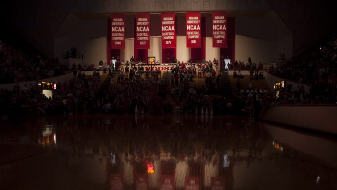 Indiana's NCAA men's basketball championship banners are illuminated before player introductions.