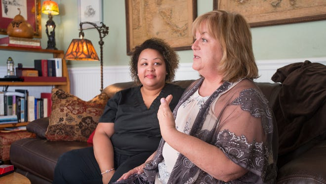 """Taylor Finkelstein, left, listens as her mother Linda, who is the local president of National Alliance on Mental Illness (NAMI), talks about the organization and their personal experience with mental illness at their home in Pensacola on Monday, April 30, 2018.  NAMI is organizing an """"Ending the Silence"""" walk that will be held at Blue Wahoos stadium on May 12th."""
