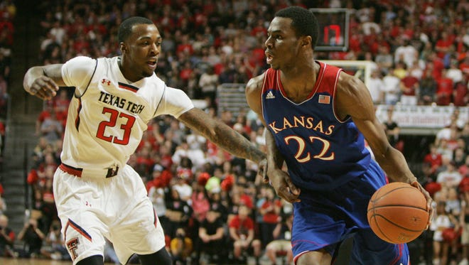 Kansas Jayhawks guard Andrew Wiggins looks for an opening against Texas Tech Red Raiders guard Jamal Williams, Jr. in the first half at United Spirit Arena.