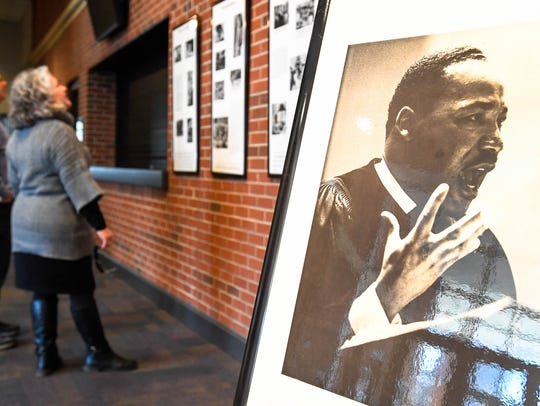 People look at a Martin Luther King display at the Henderson Fine Arts Center in January 2018.